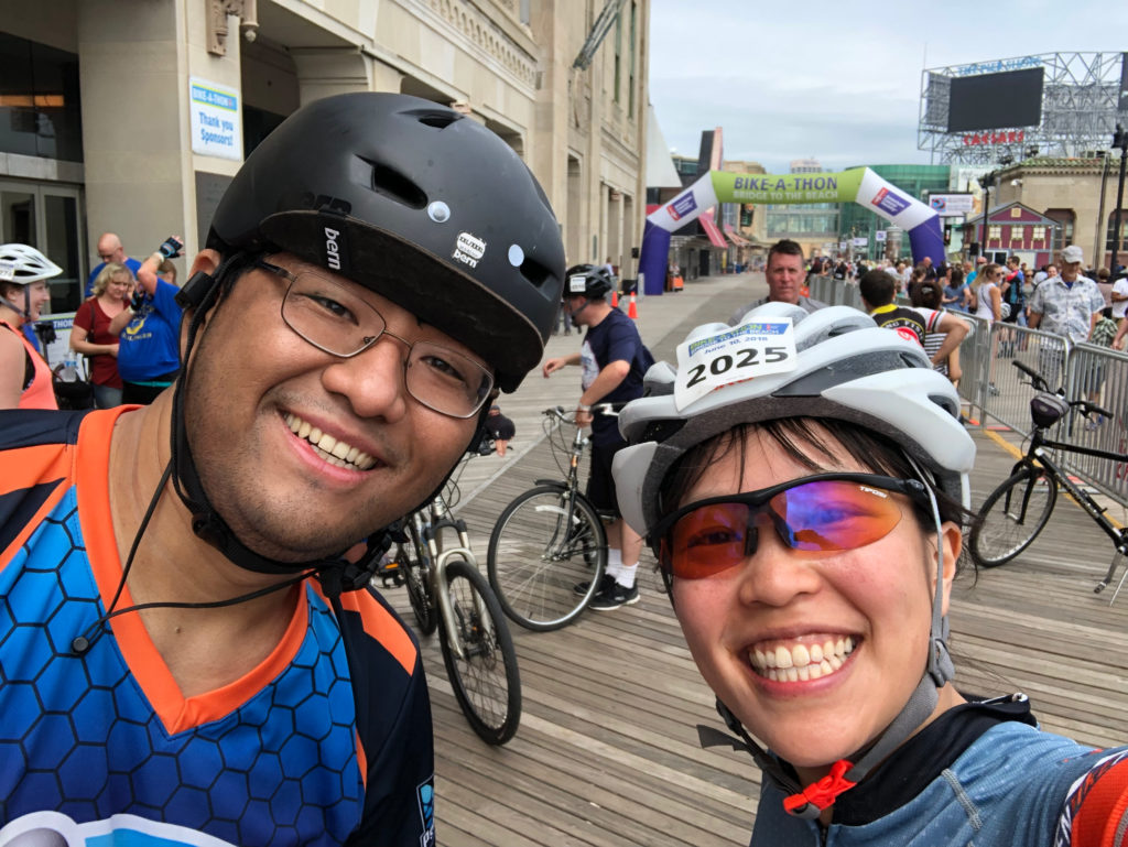 two cyclists on the boardwalk at the end of a long ride